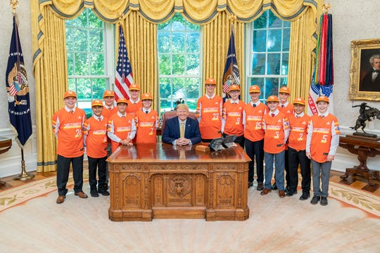 President Donald J. Trump poses for a photo with Little League Baseball World Championship Team Louisiana's Eastbank Little League Friday, Oct. 11, 2019, in the Oval Office of the White House.