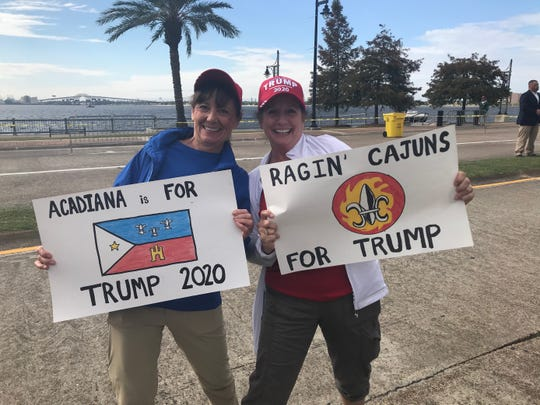 Friends Toni Kretzer and Samantha Meche of Lafayette travel to Lake Charles to attend a GOP rally featuring President Donald Trump.