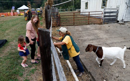 Nancy Ward, right, talks to guests at Sharp Farms Thursday afternoon, Oct. 3, 2019, near Sugar Grove.