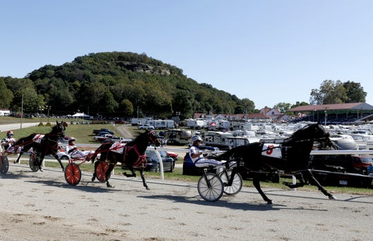 Horses race around the track Wednesday afternoon, Oct. 9, 2019, at the Fairfield County Fair in Lancaster.