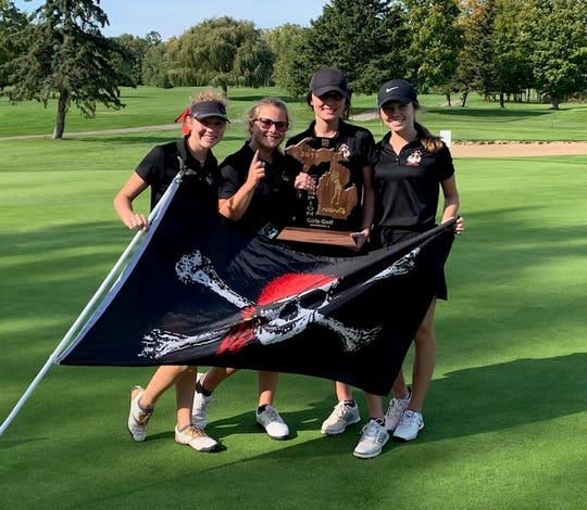 Pinckney's girls golf team of (left to right) Olivia Ohmer, Maddy Worrilow, Allison Elliott and Carlee Christopher won the first regional championship in program history on Thursday, Oct. 10, 2019.