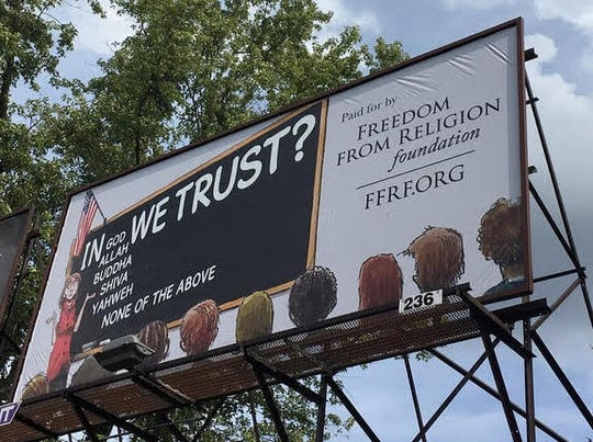 "Freedom From Religion Foundation, a Wisconsin-based group, is launching an art contest and billboard campaign in Louisville that protests the Kentucky's recently-enacted law requiring all public schools to display the ""In God We Trust"" motto."
