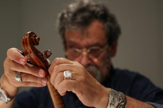Amnon Weinstein restores an instrument which is part of Violins of Hope collection