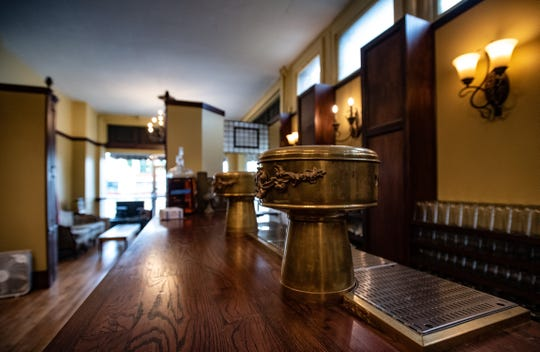 Two vintage brass mushroom tap towers adorn the bar at Sleepwalker Spirits and Ale, slated to reopen by the end of October in their new REO Town location.  Artist Tom Sheerin created the brass trim around the base to match the tap towers.