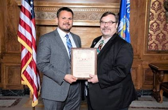 Manitowoc County Sheriff's Office Investigator Andrew Beck accepts the First Responder of the Year Award from State Rep. Paul Tittl at the State Capitol on Oct. 10.