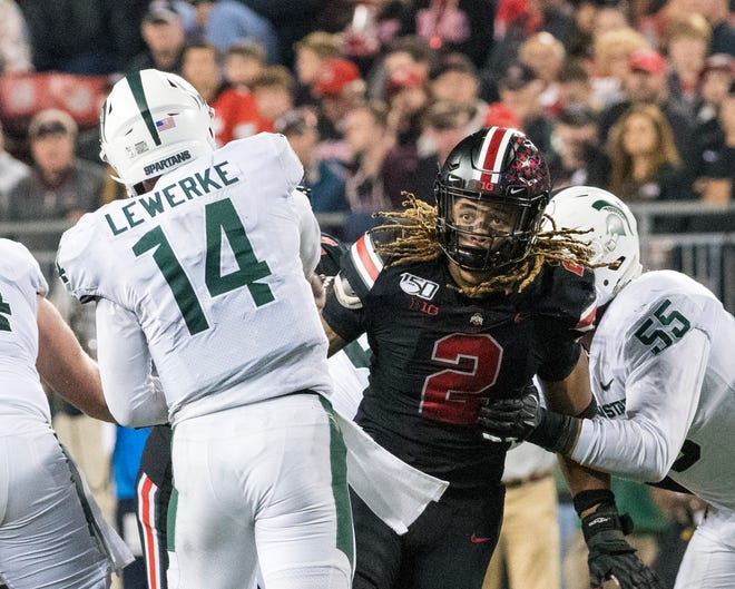 Ohio State defensive end Chase Young has Michigan State quarterback Brian Lewerke in his sights last Saturday. Has Young been Ohio State's mid-season MVP?
