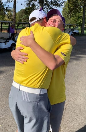 Lexington junior Trevor Dials gets a hug from golf coach Greg Smith after qualifying for the Division I state tournament with his third-place finish in Thursday's district tournament.