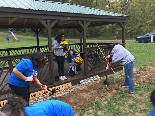 Flowers were planted by Friendly House kids Friday night at the new gazebo at Happy Hollow Day Camp on Hull Road.