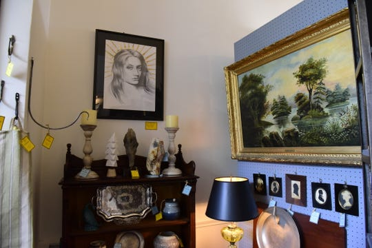 Several pieces of local art are scattered among antiques in Lucah Designs.