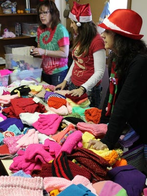 Volunteers work the distribution tables during the 2016 edition of the Junior Service Guild's Christmas Clearinghouse. Registration for the 2019 edition begins Monday, Oct. 21, from 4:30 to 7:30 p.m. at 1680 Marion-Waldo Road. For information, contact coordinator Jodi Rife at 740-341-5871.