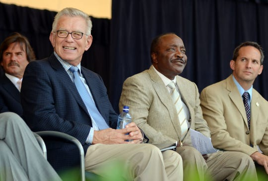 From left, Tim McCarver, National Baseball Hall of Famer Joe Morgan and National Baseball Hall of Fame President, Jeff Idelson, participate in the 2012 Ford C. Frick and J.G. Taylor Spink Award Ceremony at Doubleday Field in Cooperstown, N.Y., Saturday, July 21, 2012. McCarver accepted the Ford C. Frick award for excellence in baseball broadcasting as part of the Baseball Hall of Fame Induction ceremonies. (AP photos/Heather Ainsworth)