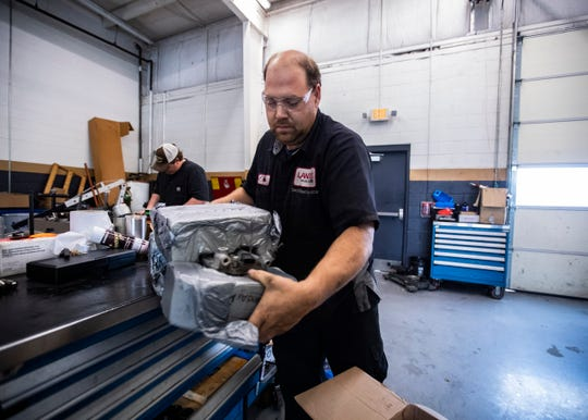 Auto technician, Mitch Lickteig works on the lifters of a 2015 GMC Sierra truck at the Landers Buick GMC in Southaven, Mississippi, on Friday, Oct. 11, 2019.