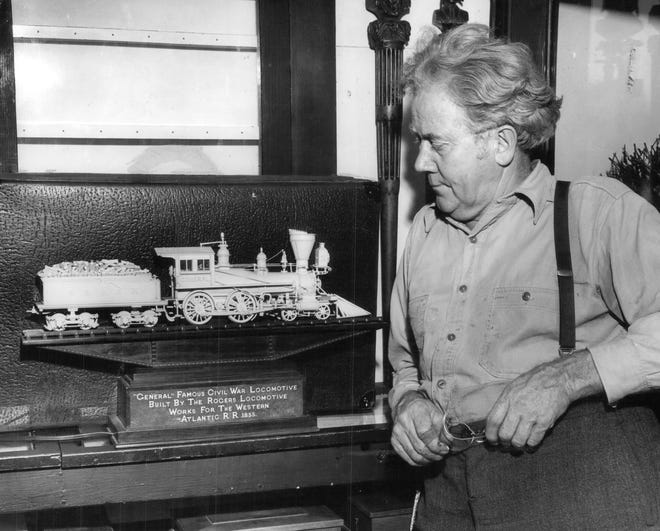 "1947: Ernest Warther looks over what he calls his masterpiece, an all ivory model of the famous ""General"" a Civil War locomotive built by the Roger Locomotive Works for the Western Atlantic Railroad in 1855.  Even the wood in the tender is made of ivory."