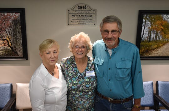Receptionist supervisor Janet Moresi (center) poses with Ann Glueck (left) and Ray Glueck (right) in Baxter Regional Medical Center's refurbished radiology waiting room. The Gluecks are retired radiology technologists that spent a combined 78 years with the hospital.