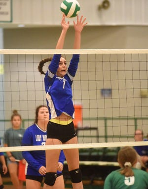Cotter's Christianne Crunkleton goes high for a block attempt during a recent match.
