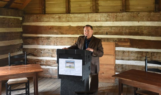 Site supervisor Marlon Mowdy talks about the history of Jacob Wolf House on Friday in the building's upstairs courtroom.