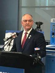Gov. John Be Edwards addresses reporters Friday at SOWELA Technical College in Lake Charles in advance of President Trump's trip to the city to rally Republican voters against Edwards, a Democrat.