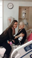 Kinnelon senior Amanda Sienicki did six rounds of chemotherapy and three weeks of radiation to combat Hodgkin's lymphoma when she was in seventh grade. She is pictured with her cousin Cassady Leonard at Hackensack University Medical Center.