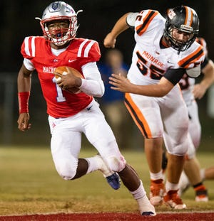 Macon East's Cephus Cleveland (1) carries against Monroe Academy on the Macon East campus in Cecil, Ala., on Thursday October 10, 2019.