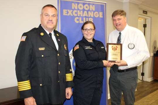 RCFR Chief Larry Farley, Firefighter Stover and Brian Hongsermeier (Noon Exchange Club Treasurer)