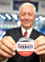 Belmont University President Bob Fisher holds a debate button at the 2020 Presidental Debate announcement Friday, Oct. 11, 2019, at Curb Event Center at Belmont University in Nashville, Tenn.