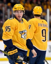 Nashville Predators center Matt Duchene (95) and left wing Filip Forsberg (9) get into position against the Washington Capitals during the first period at Bridgestone Arena in Nashville, Tenn., Thursday, Oct. 10, 2019.