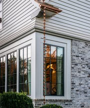 A decorative copper gutter chain has not seen a lot of rain this fall.  The feature guides water away from the home's foundation to a surface drain.