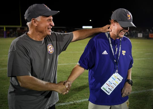 Former Trousdale County football coach Clint Satterfield congratulates his son Blake, current head coach of the team, after their win over Westmoreland at Jim Satterfield Stadium in Hartsville, Tenn. Jim Satterfield, Clint Satterfield's father, was a coach in the program from 1955 to 1996.