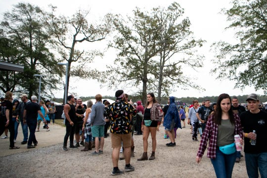 People walk around during the Exit 111 Rock Festival at Great Stage Park Friday, Oct. 11, 2019, in Manchester, Tenn.