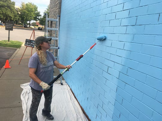 Local artist April James paints the base of Brentwood's first public mural Oct. 11, 2019.