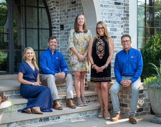 Castle Homes design-build team created the over 6,000 square foot English Arts & Crafts home in collaboration with architect Kevin Coffey. Pictured left to right, Rachel Haag, Brett Wright, Joy Huber, Heather Looney and Alan Looney, company founder/president.