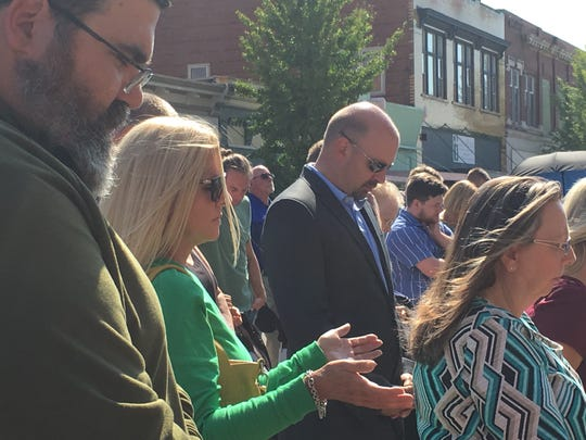 Residents bowed their heads in unison and lifted their voices in song during Gov. Bill Lee's Day of Prayer and Fasting, held in the middle of the street in front of the Robertson County Courthouse on Oct. 10, 2019.