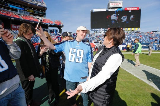 Titans superfan Matt Neely poses for a photo with Titans controlling owner Amy Adams Strunk in 2017 at Nissan Stadium.