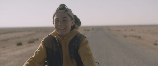 """""""Nefta Football Club"""": In the south of Tunisia, two football fan brothers bump into a donkey lost in the middle of the desert along the Algerian border. Strangely, the animal is wearing headphones over its ears."""
