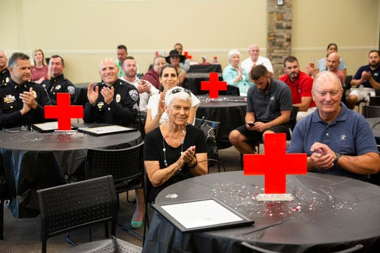 Friends and relatives clap during a Red Cross Lifesaving Award Presentation on Friday, October 11, 2019, at North Collier Regional Park Exhibit Hall in North Naples.