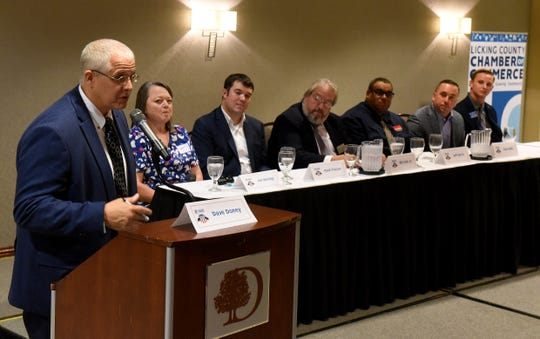 WNKO/WHTH News Director Dave Doney explains the rules of the evening to Newark City Council at-large candidates Jen Kanagy, Mark Fraizer, Bill Cost Jr., Jeff Harris, Ryan Bubb and Seth Dobbelaer before the start of the 2019 Candidates Night hosted by the Licking County Chamber of Commerce on Thursday at the DoubleTree by Hilton hotel.