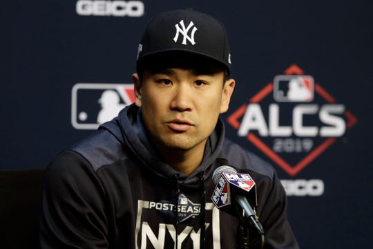 New York Yankees starting pitcher Masahiro Tanaka talks with the media during a news conference for a baseball American League Championship Series in Houston, Friday, Oct. 11, 2019. New York is handing the ball to Tanaka for Game 1 of the series against the Astros.