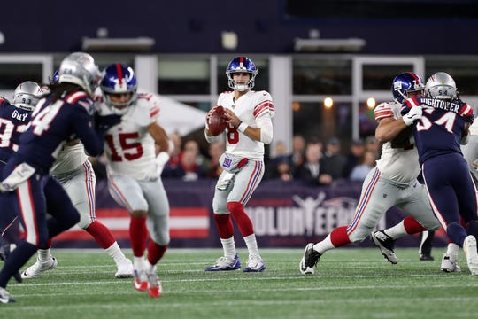 Oct 10, 2019; Foxborough, MA, USA; New York Giants quarterback Daniel Jones (8) looks to pass against the New England Patriots during the first half at Gillette Stadium.