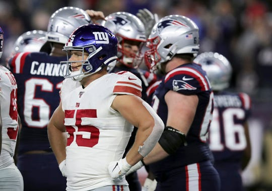 New York Giants linebacker David Mayo walks to the sideline as the New England Patriots celebrate a touchdown by Tom Brady on a quarterback sneak in the second half of an NFL football game, Thursday, Oct. 10, 2019, in Foxborough, Mass.