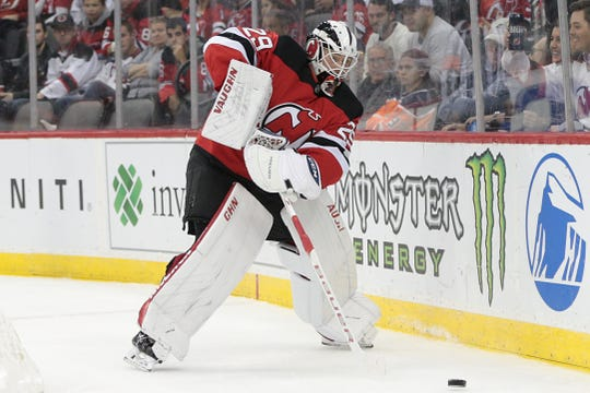 Oct 10, 2019; Newark, NJ, USA; New Jersey Devils goaltender Mackenzie Blackwood (29) controls the puck during the first period against the Edmonton Oilers at Prudential Center.