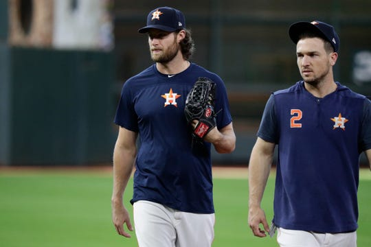 Houston Astros starting pitcher Gerrit Cole, left, and Alex Bregman, right, during a workout for a baseball American League Championship Series in Houston, Friday, Oct. 11, 2019. Houston will face the New York Yankees Saturday.