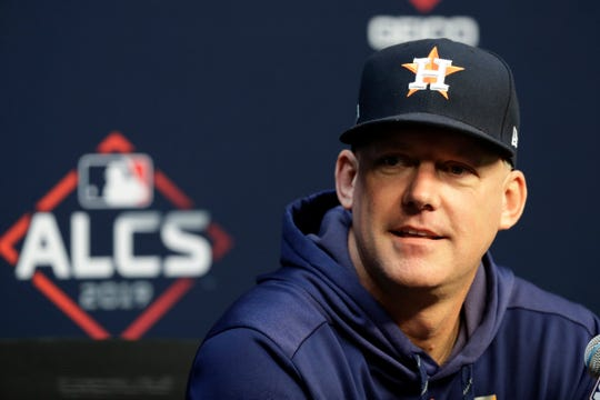 Houston Astros manager AJ Hinch talks to the media before a practice for a baseball American League Championship Series in Houston, Friday, Oct. 11, 2019. Houston will face the New York Yankees on Saturday.