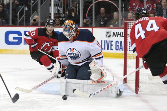 Oct 10, 2019; Newark, NJ, USA; Edmonton Oilers goaltender Mikko Koskinen (19) makes a save during the second period against New Jersey Devils left wing Miles Wood (44) at Prudential Center.