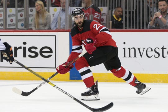 Oct 10, 2019; Newark, NJ, USA; New Jersey Devils center Kyle Palmieri (21) watches the puck during the first period against the Edmonton Oilers at Prudential Center.