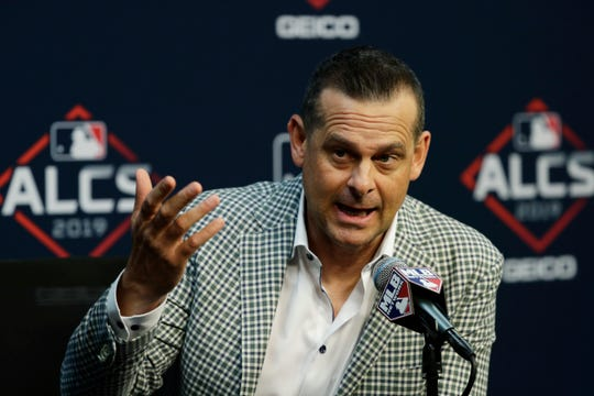 New York Yankees manager Aaron Boone talks with the media during a news conference baseball 'sAmerican League Championship Series in Houston, Friday, Oct. 11, 2019. New York is scheduled to face the Houston Astros starting Saturday.