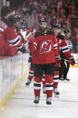 Oct 10, 2019; Newark, NJ, USA; New Jersey Devils center Kyle Palmieri (21) celebrates his goal with teammates during the first period against the Edmonton Oilers at Prudential Center.