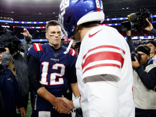 Oct 10, 2019; Foxborough, MA, USA; New England Patriots quarterback Tom Brady (12) shakes hands with New York Giants quarterback Daniel Jones (8) after a game at Gillette Stadium.