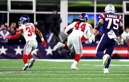 Markus Golden #44 of the New York Giants recovers a fumble to score a touchdown against the New England Patriots during the second quarter in the game at Gillette Stadium on October 10, 2019 in Foxborough, Massachusetts.