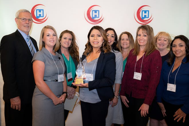 Representatives from Rehabilitation Hospital of Southern New Mexico pose with the 2019 Quest for Excellence Award, the New Mexico Hospital Association's premier specialty hospital honor for hospital quality and performance improvement.