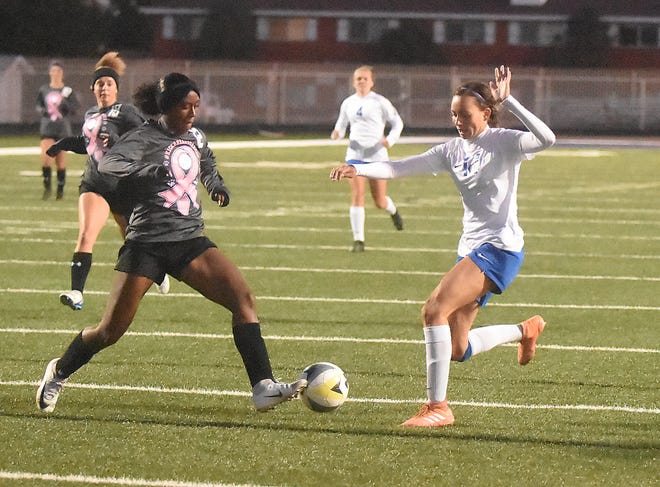 Emily Hervol races with Clovis' Kiyhra Lilly for the ball in the first half of Thursday's match at Leon Williams Stadium in Clovis. The game ended in a 2-2 tie.
